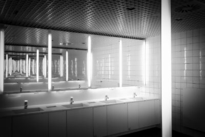 public restroom mirror and sinks need Houston janitorial services