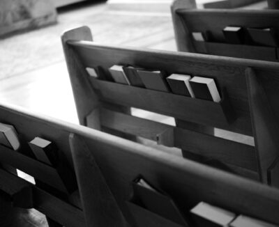 books sitting in church pews