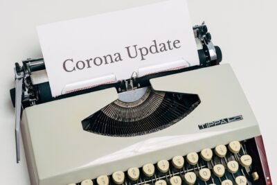 typewriter with corona update for Houston commercial cleaning