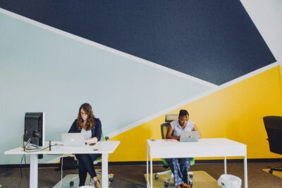 people at desks in hot desking or coworking office